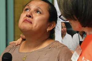 Stamford resident Carla Esquivel, left, sheds a tear while sharing her story of immigrating from Guatemala as Building One Community Executive Director Catalina Horak shows support at the Together We Stand #StamfordWelcomesImmigrants community meeting at Building One Community in Stamford, Conn. Monday, Aug. 12, 2019. In the wake of recent mass shootings in El Paso and Dayton, local immigrants shared their stories in front of representatives from the Stamford Police Department, Stamford Public Schools, City Government and Interfaith Council in a message of unity and support.