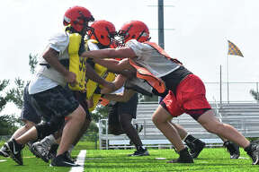 Edwardsville football was back to work Monday with its first practice of the fall season. Monday marked the first day all IHSA-sanctioned sports in the fall could begin practicing.