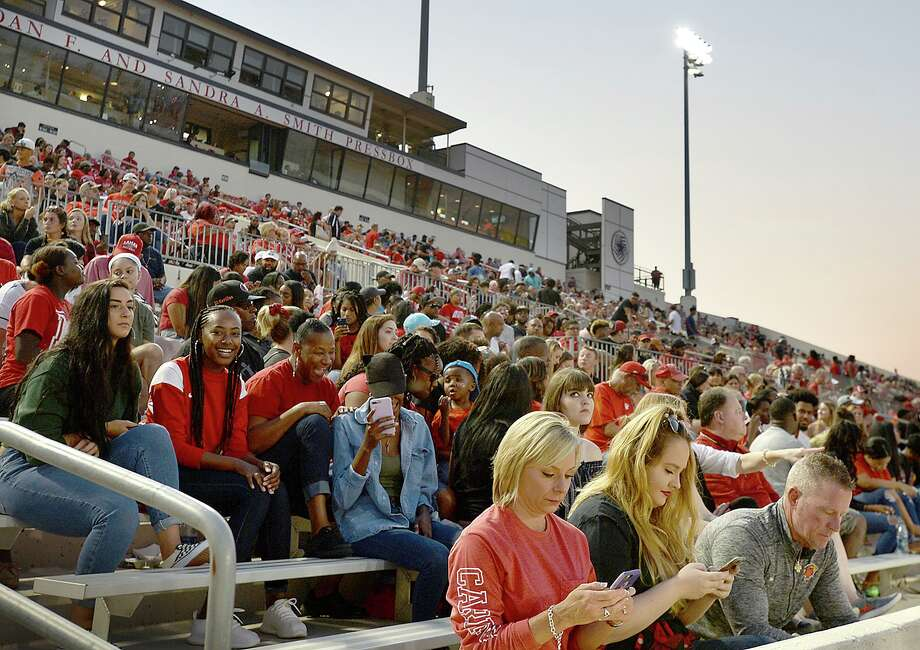 Lamar's fans fill the stands during Saturday's season home opener against UT Permian Basin. The Cardinals game was free entry, with the stands largely full by the end of the first quarter. It was among the ways the university is trying to give back to the community, offering a taste of normal life for citizens and students alike in the wake of Tropical Storm Harvey. Photo taken Saturday, September 9, 2017 Kim Brent/The Enterprise Photo: Kim Brent / Beaumont Enterprise / BEN
