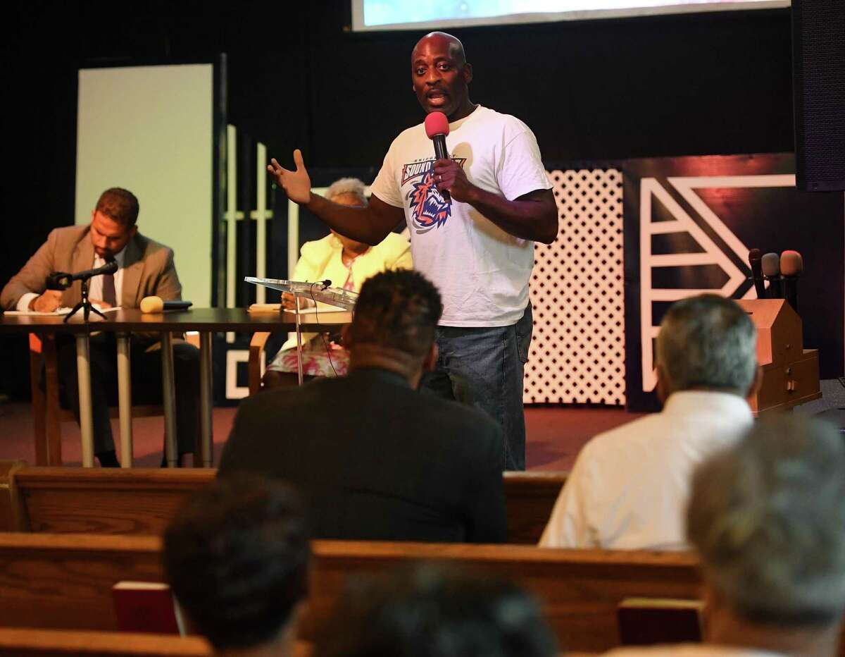 Joseph Alexis, of Bridgeport, talks about jobs that never materialized in the construction of PSEG's new Bridgeport power plant during a community conversation at Shiloh Baptist Church in Bridgeport on Monday, August 12, 2019. State senators Dennis Bradley, left, and Marilyn Moore attended the meeting to hear residents' concerns.