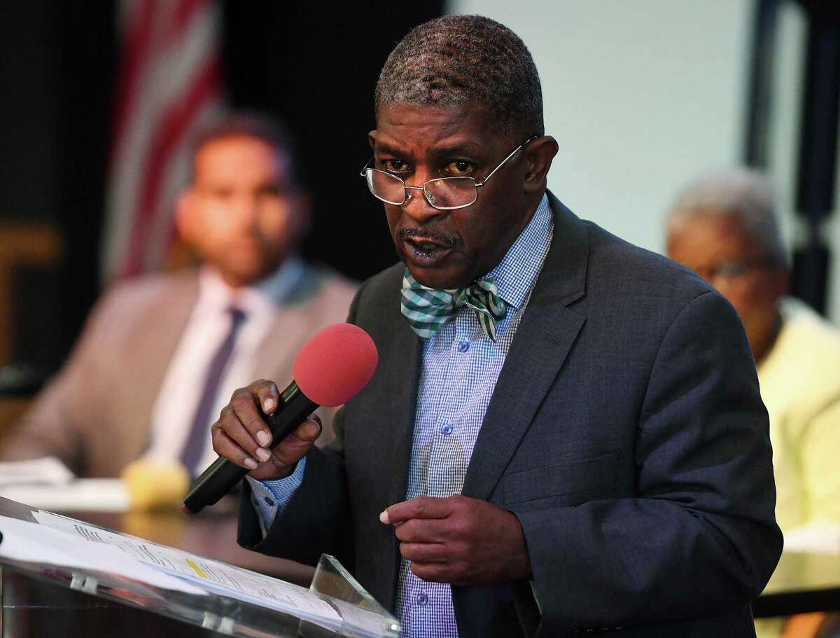 Chapman Walsh, of Atlanta, GA, testifies about PSEG's failure to deliver on the promise of jobs for city residents in the construction of the new Bridgeport power plant, during the Straight Talk for Straight Understanding community conversation at Shiloh Baptist Church in Bridgeport, Conn. on Monday, August 12, 2019. State senators Dennis Bradley, left, and Marilyn Moore attended the meeting to hear residents' concerns.