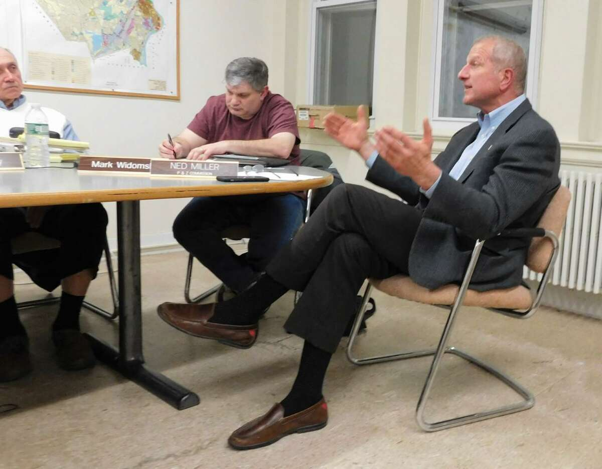 Mayor Mark Lauretti, right, criticizes the P&Z over recent actions during the March 19 commission meeting on Planned Development District regulations. Member Mark Widomski is on the left.