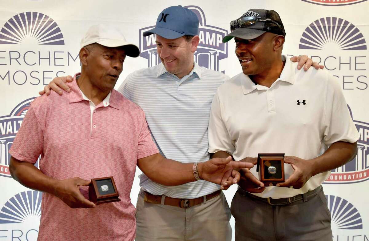 The Walter Camp Football Foundation golf tournament held a Ring of Honor ceremony Monday for former NFL football players Tony Dorsett, left, and Tim Brown, right, with Walter Camp President Mario Coppola, center, at the Race Brook Country Club.