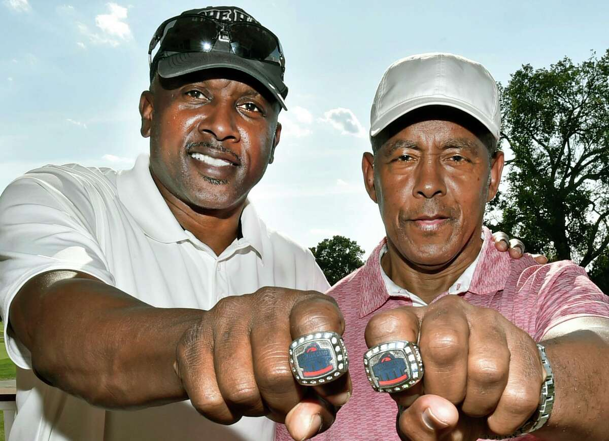 The Walter Camp Football Foundation golf tournament held a Ring of Honor Ceremony for former NFL football players Tim Brown, left, and Tony Dorsett Monday at Race Brook Country Club.