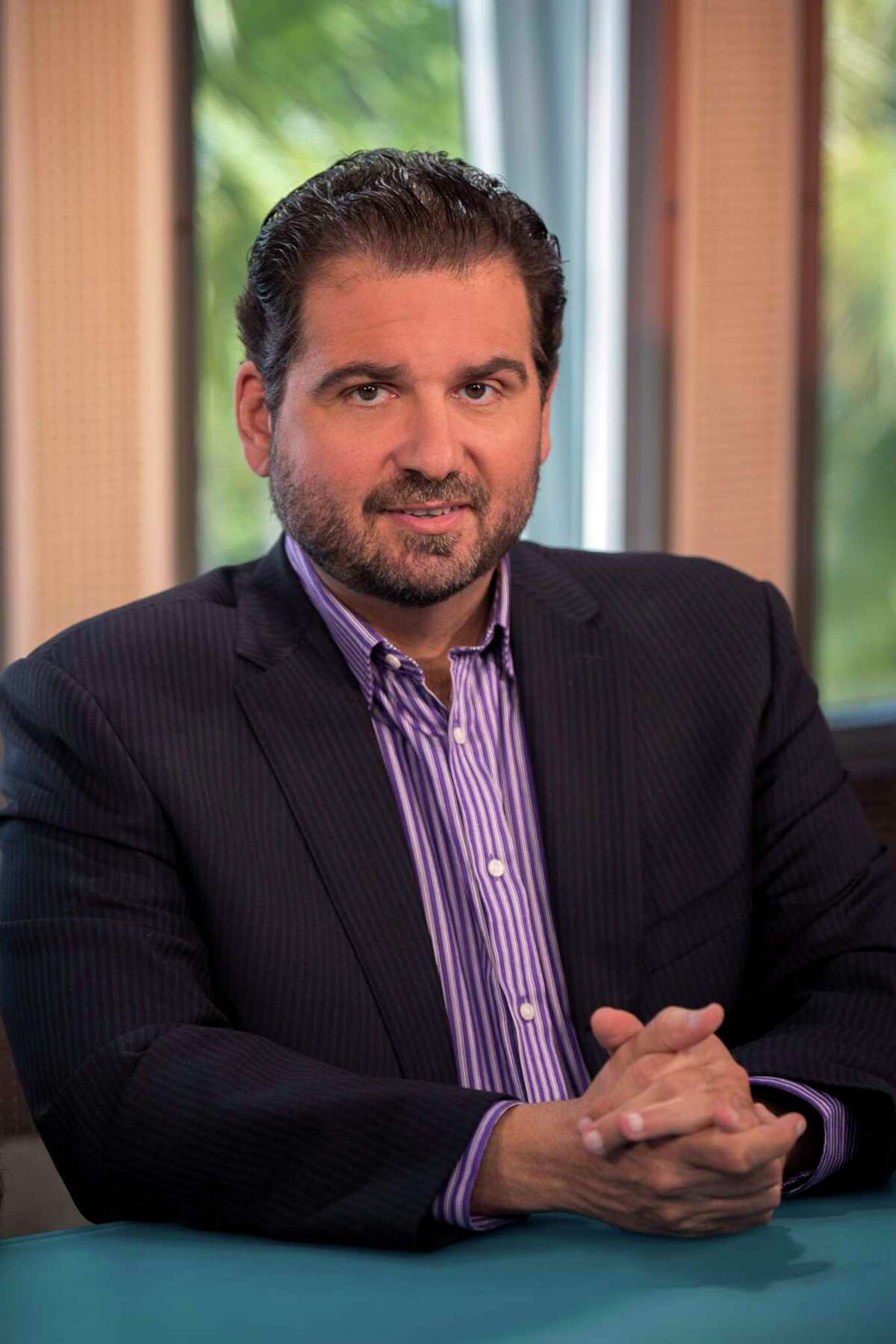 This Nov. 11, 2014, photo provided by ESPN shows Dan Le Batard on the set of Highly Questionable in Miami, Fla. ESPN's Dan Le Batard was away from his radio show Monday, July 22, 2019, after attracting attention for criticizing President Donald Trump's racist tweets and his network's policy of avoiding politics unless it involved sports. (Rodrigo Varela/ ESPN Images via AP)