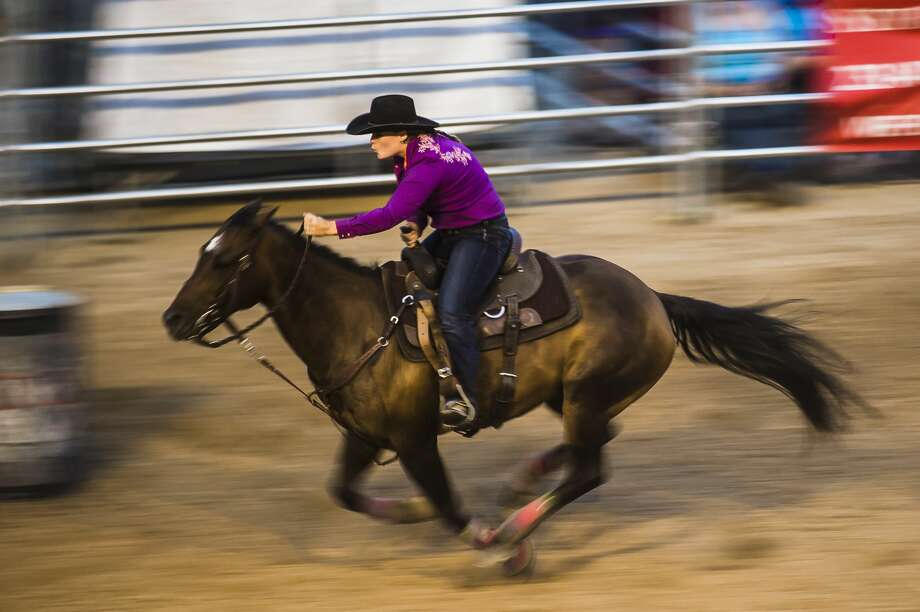 Maria Heilig competes in barrel racing during the Super Kicker Rodeo on Monday, Aug. 12, 2019 at the Midland County Fairgrounds. (Katy Kildee/kkildee@mdn.net) Photo: (Katy Kildee/kkildee@mdn.net)
