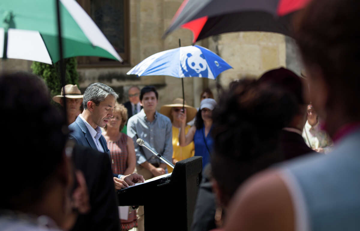 """Mayor Ron Nirenberg speaks to community members and those watching a live broadcast about the recent violence seen around the nation, Monday, August 12, 2019, at the Main Plaza downtown San Antonio. Sister Cities around the nation gather together at noon to speak up and out about the recent shootings and the violence seen throughout our nation. Claudette Copeland, Pastor of New Creation Christian Fellowship shared the importance of the gathering in San Antonio. """"People get amnesia quickly about trauma, death and dying. If El Paso did not wake us up, if the slaughter of innocent people did not move us, the people of goodwill must cry out."""" """"It's a day to grieve and morn and a day to initiate action."""" Rebecca Slezak/Staff photographer"""