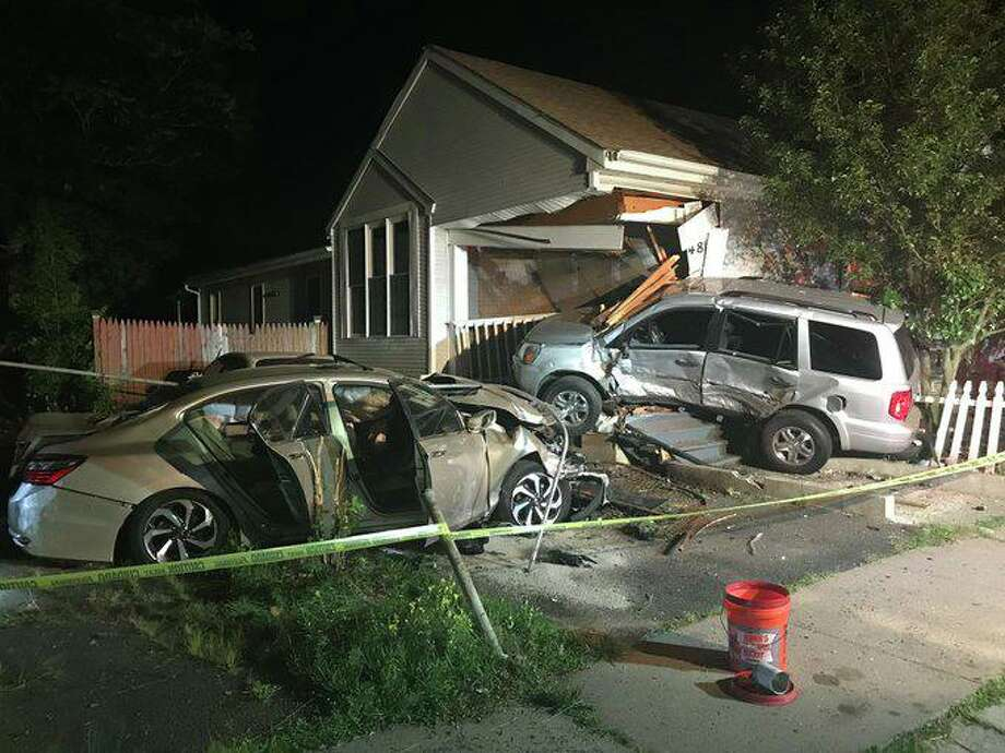 A car was sent flying into a Hamden home after a two-car collision. One was sent to the hospital. Photo: Contributed Photo / Hamden Fire Department