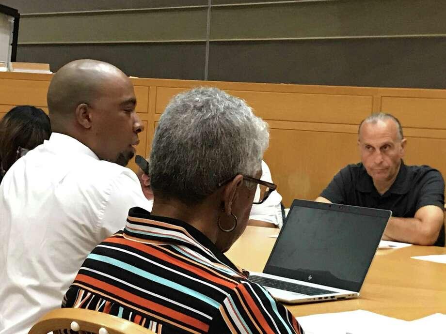 Acting Budget Director Michael Gormany and interim Health Director Roslyn Hamilton testify on Aug. 12, 2019. Photo: Brian Zahn/Hearst Connecticut Media