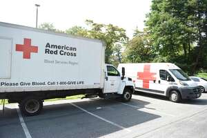 American Red Cross vehicles are parked outside the Blood Drive at Temple Sholom in Greenwich, Conn. Monday, Aug. 5, 2019.