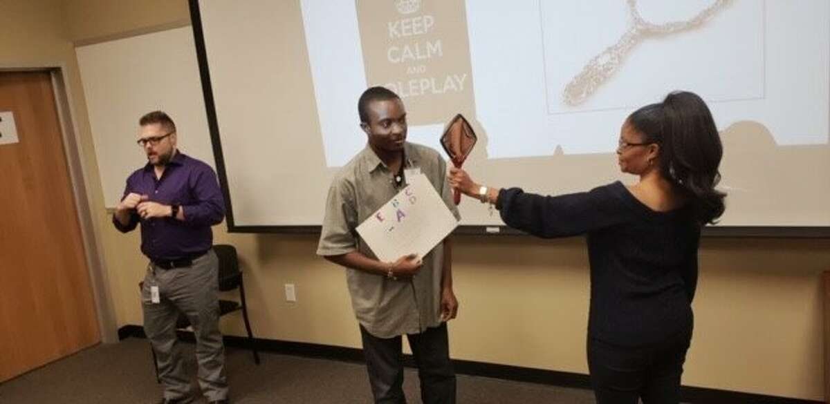 """""""Self-Presentation: Visual Resume"""" Workshop for Goodwill Houston Job Connection PSAT/WAT Job Training Program in September 2018. Sessions have accommodations, like an ASL interpreter, to aid members who need it."""