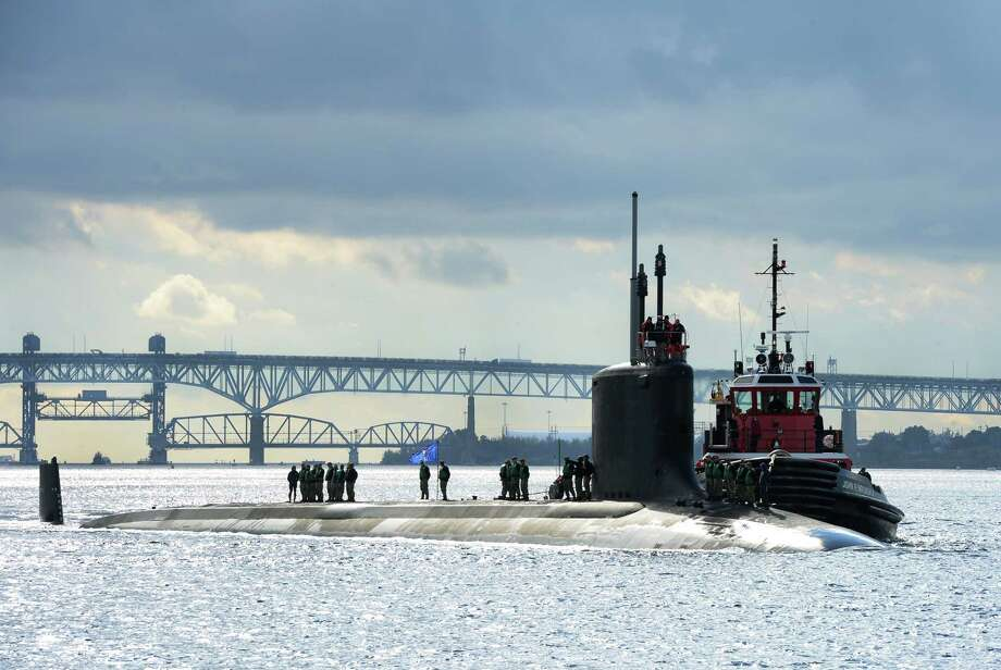The Virginia-class fast-attack submarine USS Indiana transits the Thames River as it arrives at its new homeport at Naval Submarine Base New London in Groton, Conn., on Oct. 29, 2018. Photo: U.S. Navy Photo By Mass Communication Specialist 1st Class Steven Hoskins. / Public Domain