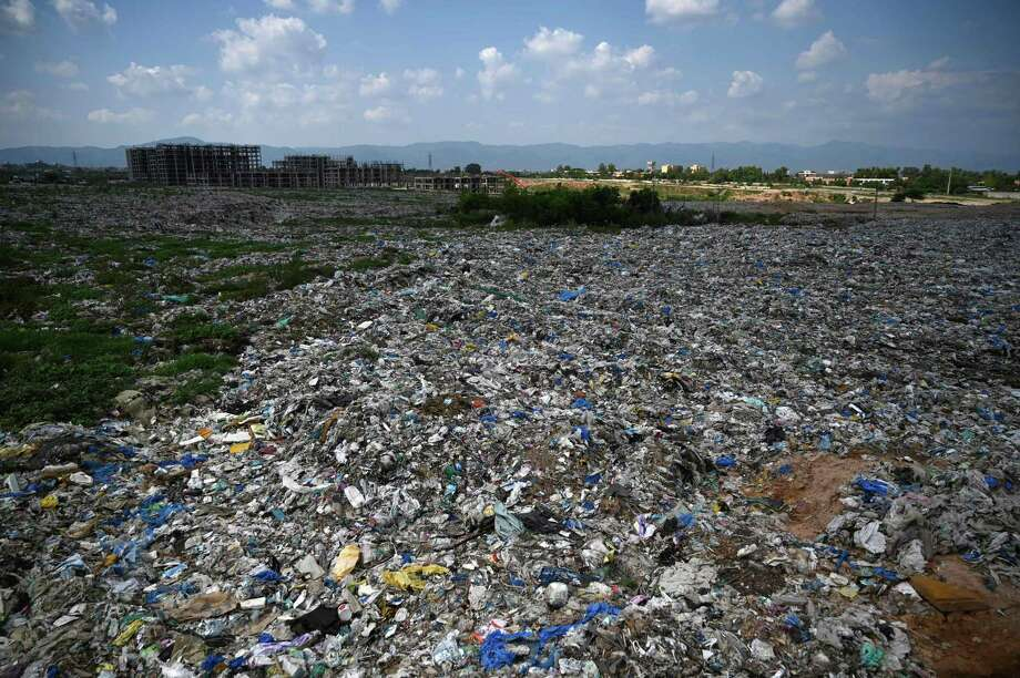 This picture taken on July 30, 2019 shows a general view of a trash site full of plastic bags on the outskirts of Islamabad. - From the once pristine rivers of Hindu Kush to the slums of Islamabad, Pakistan is being smothered by plastic due to a lack of public awareness, government inertia, and poor waste management. (Photo by AAMIR QURESHI / AFP) / TO GO WITH Pakistan-environment-plastic,FEATURE by Joris FioritiAAMIR QURESHI/AFP/Getty Images Photo: AAMIR QURESHI, AFP/Getty Images / AFP or licensors
