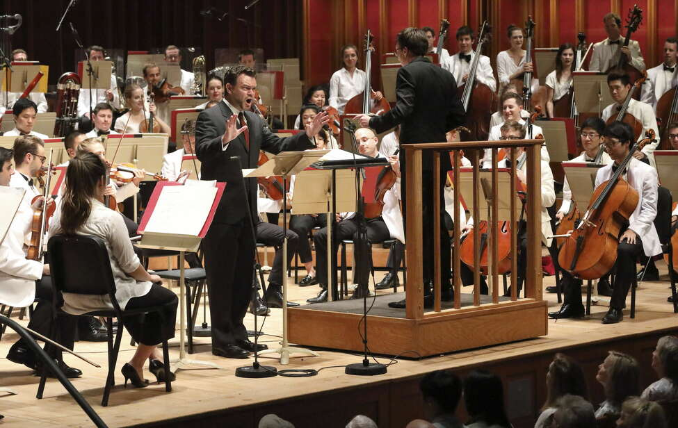 Tenor Charles Blandy and conductor Nathan Aspinall with the Tanglewood Music Center Orchestra performing Gerald Barry's Canada at Tanglewood's annual Festival of Contemporary Music Monday night.