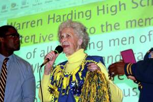 Class of 1948 graduate Sarah Masso, of Stratford, center, leads a cheer on stage in the auditorium during a Harding High School alumni party held to celebrate and commemorate the end of the old Harding building as a new one sets to open at Harding High School in Bridgeport, Conn., on Wednesday June 13, 2018.