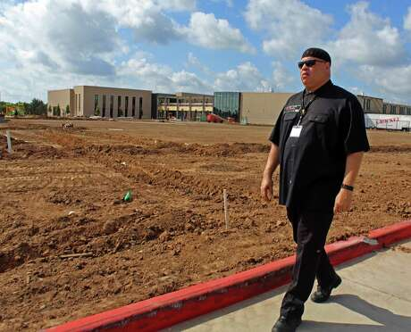 Kofi Taharka, chairman of the Houston chapter of the National Black United Front, walks past a Fort Bend school construction site where the skeletal remains of 95 convict laborers were discovered last year.