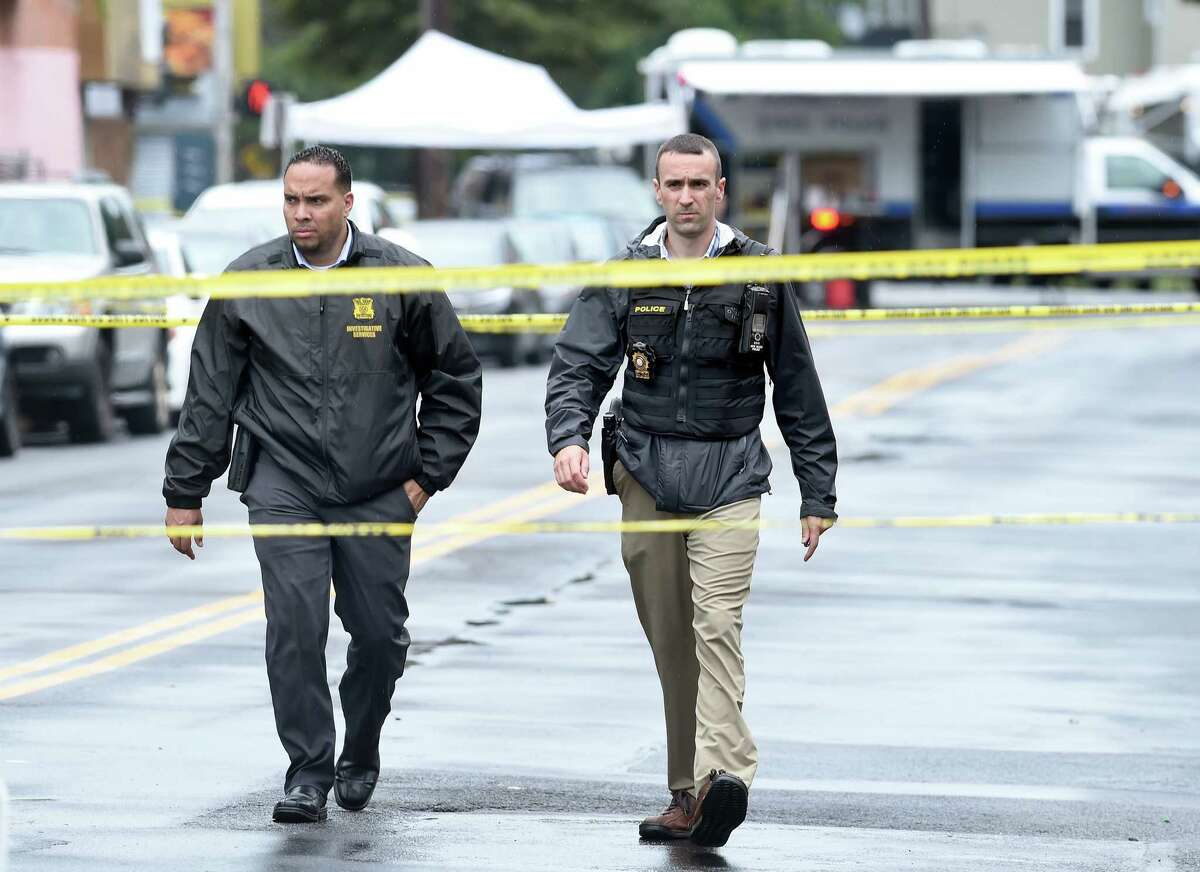 New Haven Police investigate the scene of a shooting on Henry Street in New Haven on August 13, 2019 where New Haven Police Captain Anthony Duff was shot last night responding to a shooting while off-duty.