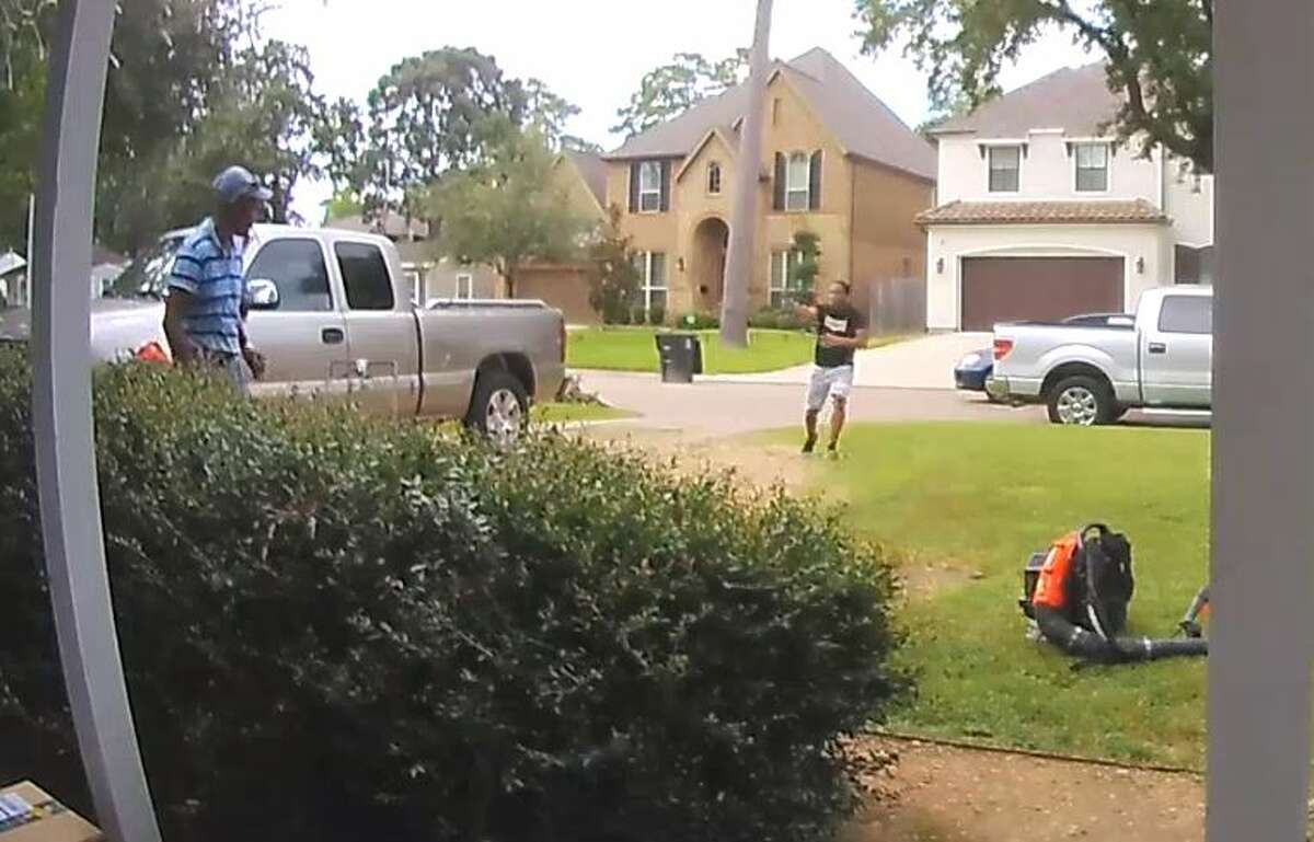 The unknown suspect can be seen running toward the lawn care worker with a gun drawn before he swoops down to pick up the leaf blower. He then flees the scene in a car parked on the other side of the street.