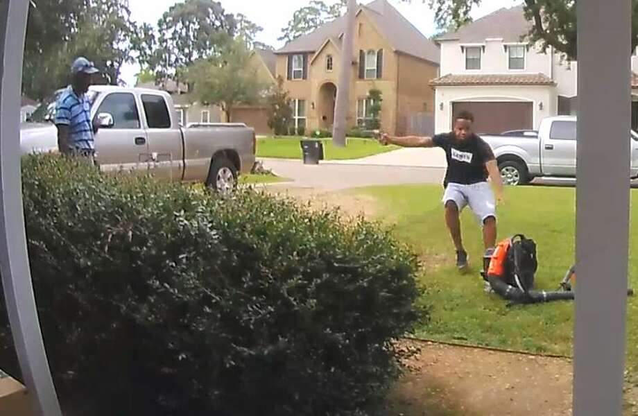 The unknown suspect can be seen running toward the lawn care worker with a gun drawn before he swoops down to pick up the leaf blower. He then flees the scene in a car parked on the other side of the street. Photo: Ring.com
