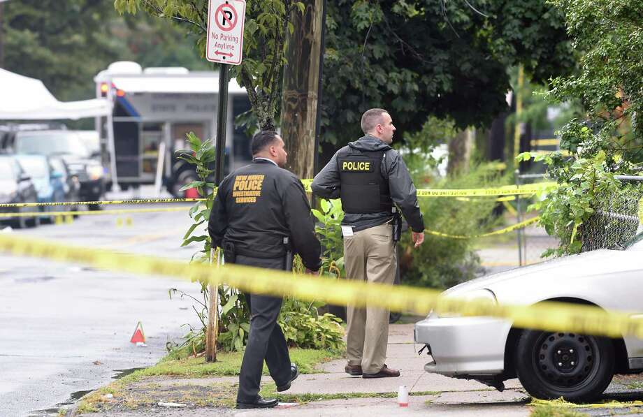 New Haven Police investigate the scene of a shooting on Henry Street in New Haven on August 13, 2019 where New Haven Police Captain Anthony Duff was shot last night responding to a shooting while off-duty. Photo: Arnold Gold / Hearst Connecticut Media / New Haven Register