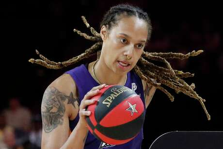 FILE - In this July 26, 2019, file photo, Phoenix Mercury's Brittney Griner competes in the skills challenge during the WNBA All-Star festivities in Las Vegas. The Mercury have been ravaged by injuries lately and may be without Brittney Griner for three games because of her role in the fight that occurred against Dallas last Saturday, Aug. 10. (AP Photo/John Locher, File)