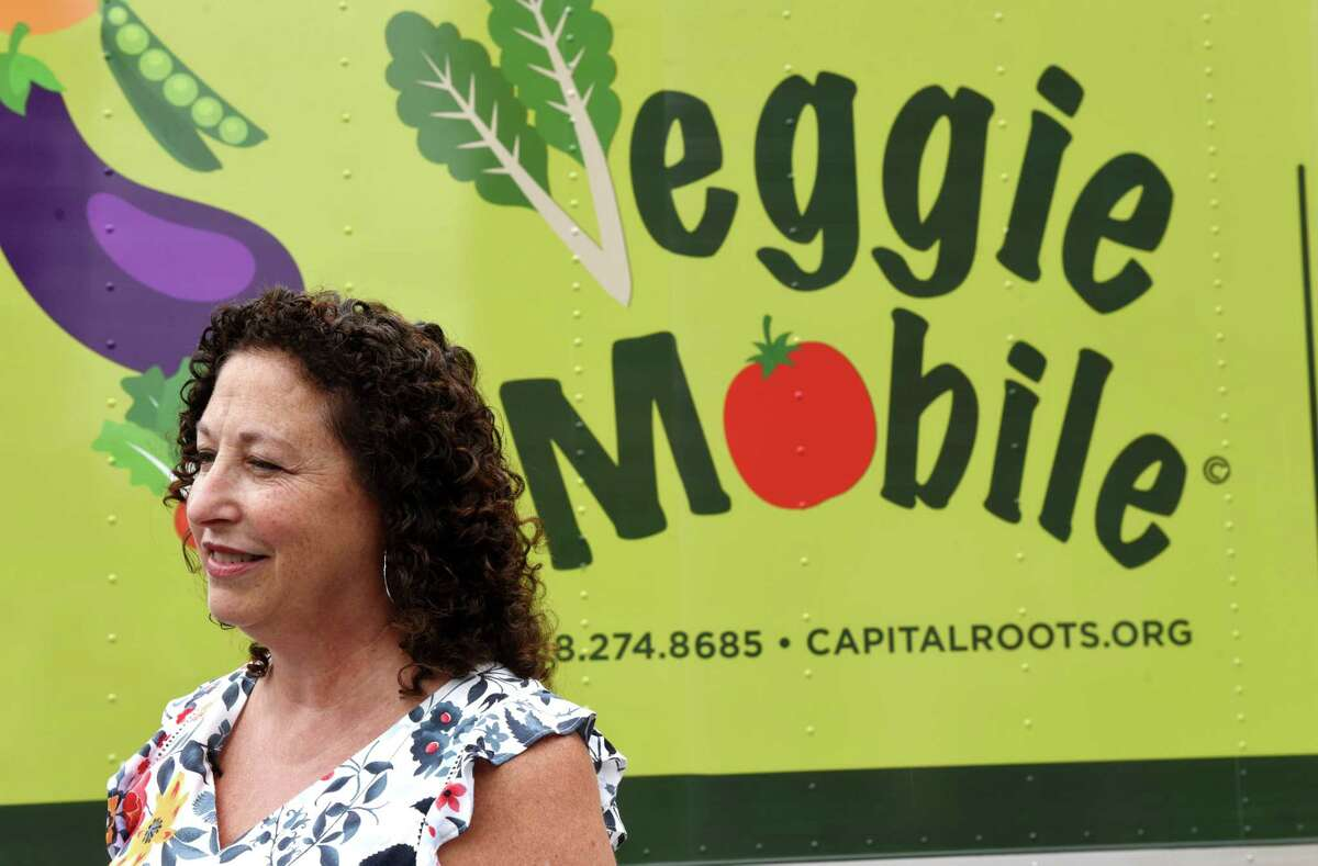 Capital Roots CEO Amy Klein speaks during the unveiling of the nonprofit's new Veggie Mobile on Tuesday, Aug. 13, 2019, in Troy, N.Y. The truck is used to provide fresh produce to inner-city neighborhoods throughout the Capital Region. (Will Waldron/Times Union)