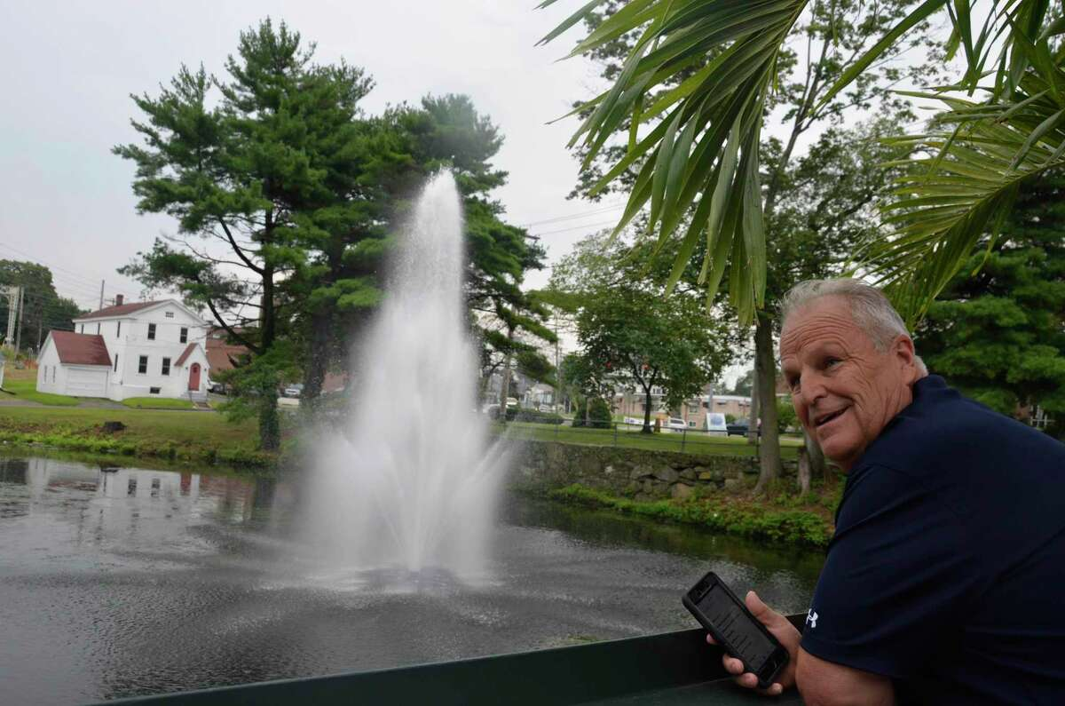 Rich Conine, owner of Stonebridge Restaurant, looks at the fountain he had placed in the pond behind his restaurant Aug. 13, 2019.