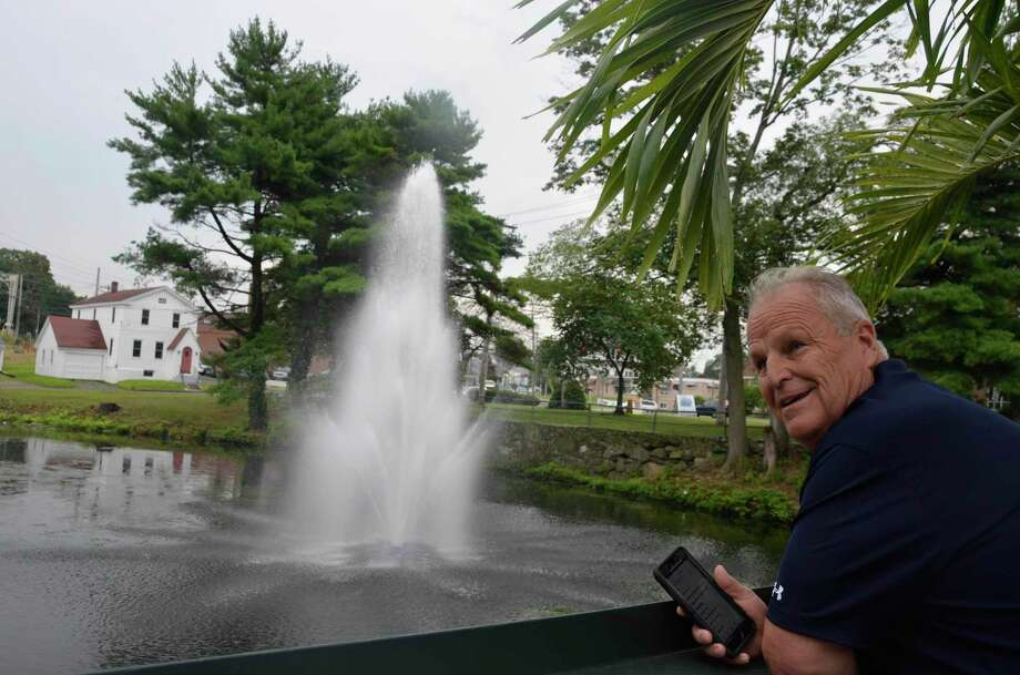 Rich Conine, owner of Stonebridge Restaurant, looks at the fountain he had placed in the pond behind his restaurant Aug. 13, 2019. Photo: Jill Dion / Hearst Connecticut Media