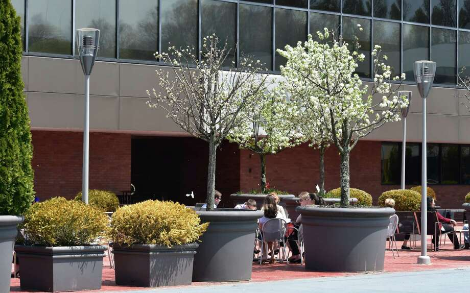 Office workers outside Xerox headquarters in Norwalk, Conn., in May 2018. Photo: Alexander Soule / Hearst Connecticut Media / Stamford Advocate