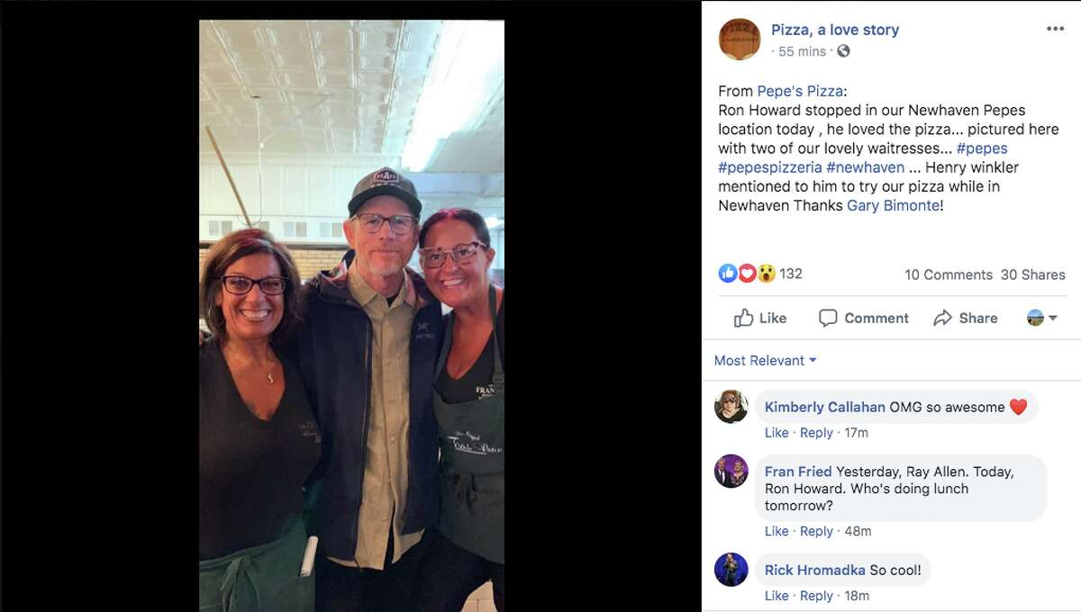Director Ron Howard (middle) was seen dining at Frank Pepe's in New Haven.