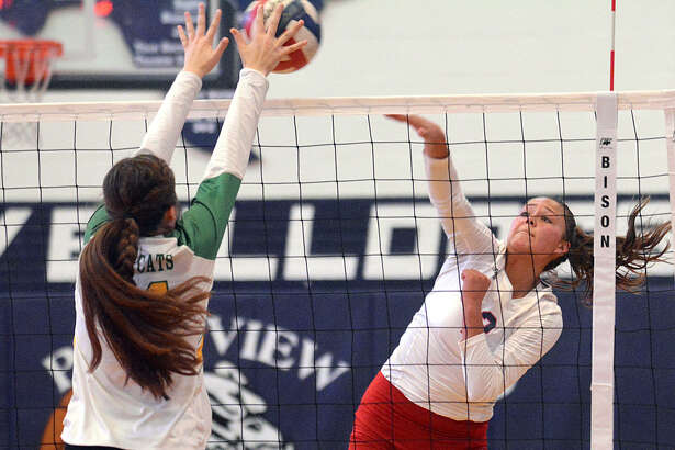 Plainview's Aspin Miller fires a kill off the hands of an Idalou defender while teammate Hannah Rodriguez looks on during their high school volleyball match on Monday at Plainview High School.