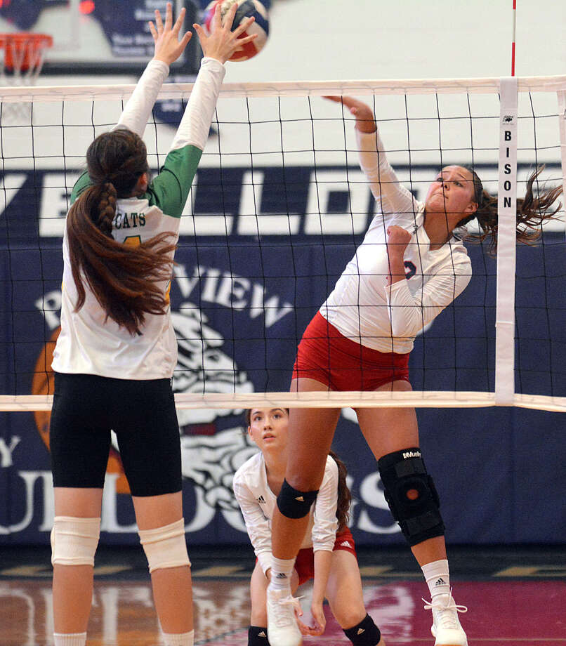 Plainview's Aspin Miller fires a kill off the hands of an Idalou defender while teammate Hannah Rodriguez looks on during their high school volleyball match on Monday at Plainview High School. Photo: Nathan Giese/Planview Herald
