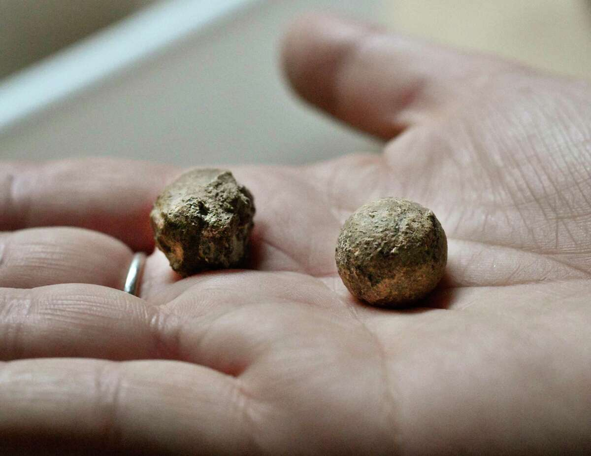 Musket balls possibly dating from the 1800s are among items found during an archaeological survey in the Long Barrack on the Alamo grounds on Tuesday, Aug. 13, 2019. The ball on the left has been shot.