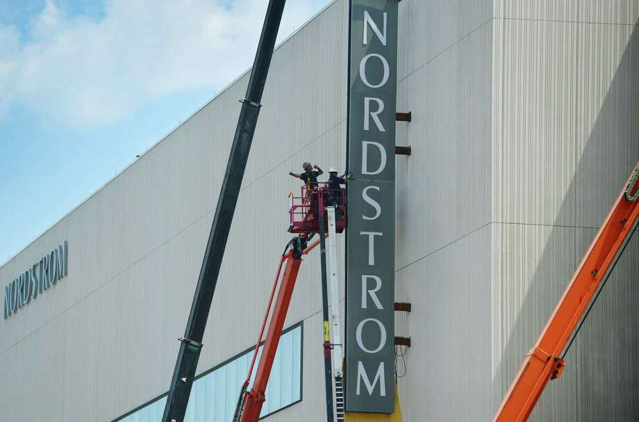 Construction workers with Brookfield Properties install Nordstrom signage in July 2019 at the SoNo Collection mall under construction in Norwalk, Conn. Photo: Erik Trautmann / Hearst Connecticut Media / Norwalk Hour