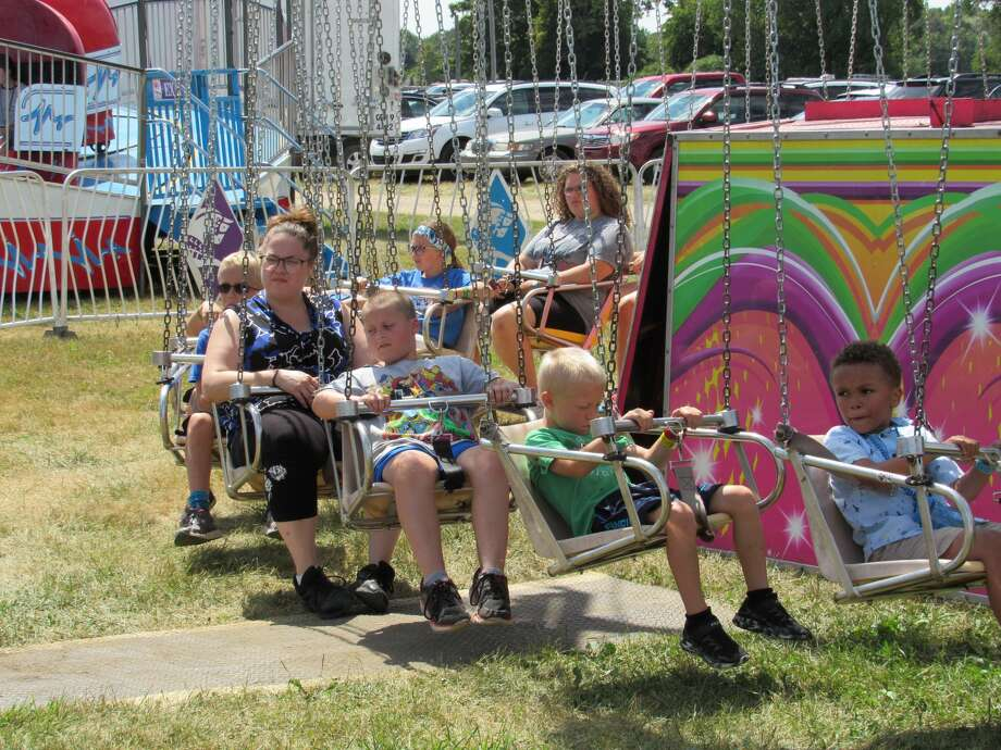 Visitors enjoy the attractions, rides and food that the Midland County Fair has to offer on Tuesday, Aug. 13, 2019. Photo: Victoria Ritter/vritter@mdn.net