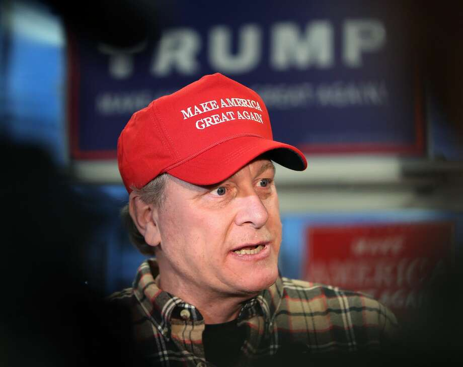 FILE - Former Boston Red Sox pitcher Curt Schilling speaks to the gathered media as he makes an appearance at a Republican Party office in Salem, NH to stump for the presidential candidacy of Donald Trump on Oct. 18, 2016. Photo: Boston Globe/Boston Globe Via Getty Images