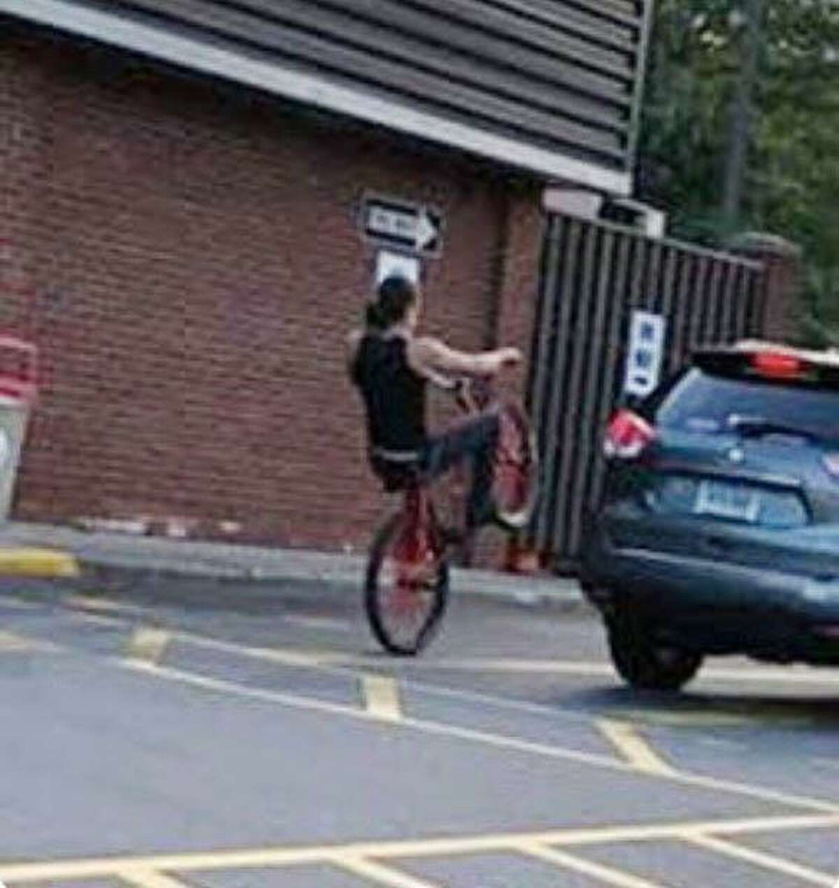 Milford police are trying to identify this bike rider, who allegedly was riding recklessly on Bridgeport Avenue last week and nearly caused car accidents.