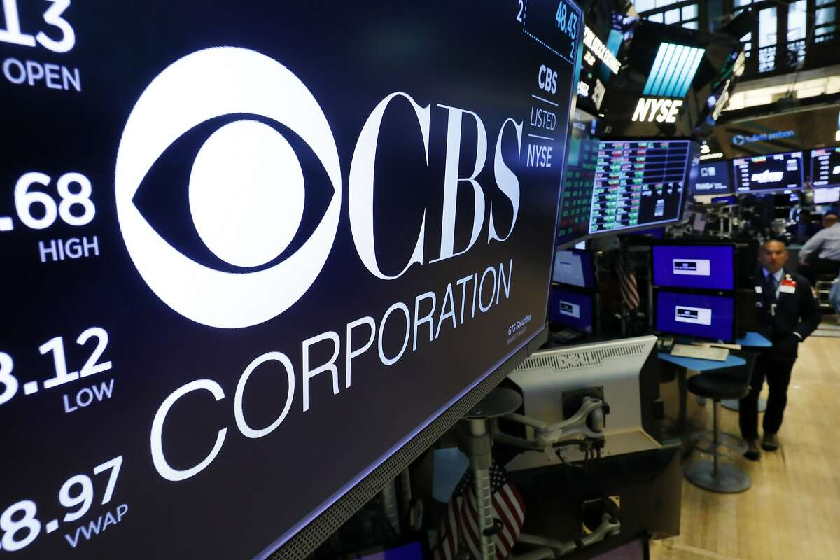The logo for the CBS Corporation appears above a trading post on the floor of the New York Stock Exchange, Tuesday, Aug. 13, 2019.