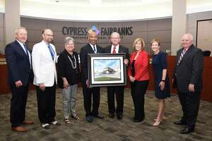 Windfern namesake: CFISD namesakes were chosen for future and existing campuses and facilities during the CFISD Board of Trustees meeting on Aug. 12. Leonard Brautigam (fourth from right), namesake for the former Windfern School of Choice, poses with Board of Trustees (from left) Don Ryan, Tom Jackson, Debbie Blackshear, Dr. John Ogletree, Darcy Mingoia, Julie Hinaman and Bob Covey.