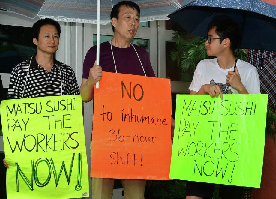 Former Matsu Sushi employees , Jianming Jiang and Liguo Ding and Flushing Workers Center organizer and translator Zishun Ning join State Senator Will Haskell, protestors and labor leaders to protest the firing the two Matsu Sushi staff members during a picket of the restaurant on Tuesday in Westport. The two employees were fired in 2017 after they refused to work three consecutive shifts. Photo: Erik Trautmann / Hearst Connecticut Media / Norwalk Hour