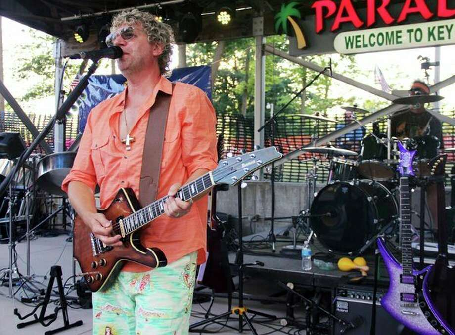 Johnny Russler and the Beach Bum Band provided entertainment Saturday at the Amphitheater during the Cheeseburger in Caseville festival. (Andrew Mullin/Huron Daily Tribune)