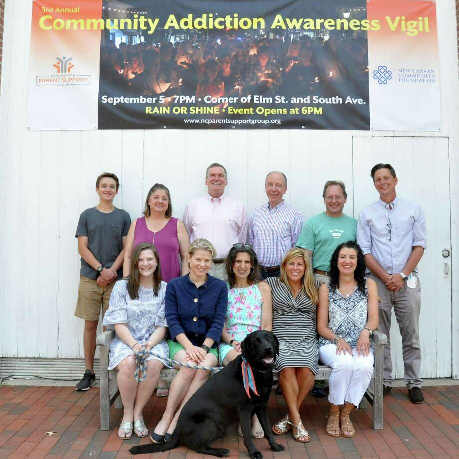 The New Canaan Parent Support Group, the New Canaan Community Foundation and other community partners have united to host the third annual Community Addiction Awareness Vigil at Elm Street a d South Avenue on Thursday, Sept. 5, starting at 6 p.m. In front are Nicole Kolenberg, New Canaan Community Foundation; Susannah Lewis, Silver Hill Hospital; Joyce Sixsmith, Ram Council; Jackie D'Louhy, Town of New Canaan; and Ellen Brezovsky, New Canaan CARES. In back are Ethan Jones, New Canaan High School Film student; Chris Otis, St. Aloysius Church; John Hamilton, Liberation Programs; Paul Reinhardt, New Canaan Parent Support Group; Derrick Fallon, St. Michael's Church and Peter Clark, Silver Hill Hospital. Photo: Contributed Photo / Valerie Stryker / New Canaan Advertiser Contributed