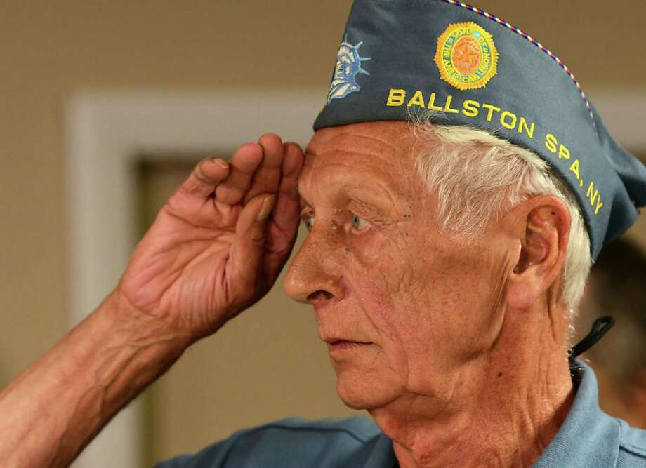 Nephew Lloyd Helman salutes during the Pledge of Allegiance as the family of WWII hero Private First Class Floyd Mabb is reunited with his Purple Heart during a ceremony at American Legion Post 234 on Tuesday, Aug. 13, 2019 in Ballston Spa, N.Y. The medal was delivered to Saratoga County Clerk Craig Hayner after it was found in the lining of a purse purchased at a local garage sale. (Lori Van Buren/Times Union) Photo: Lori Van Buren, Albany Times Union / 20047652A