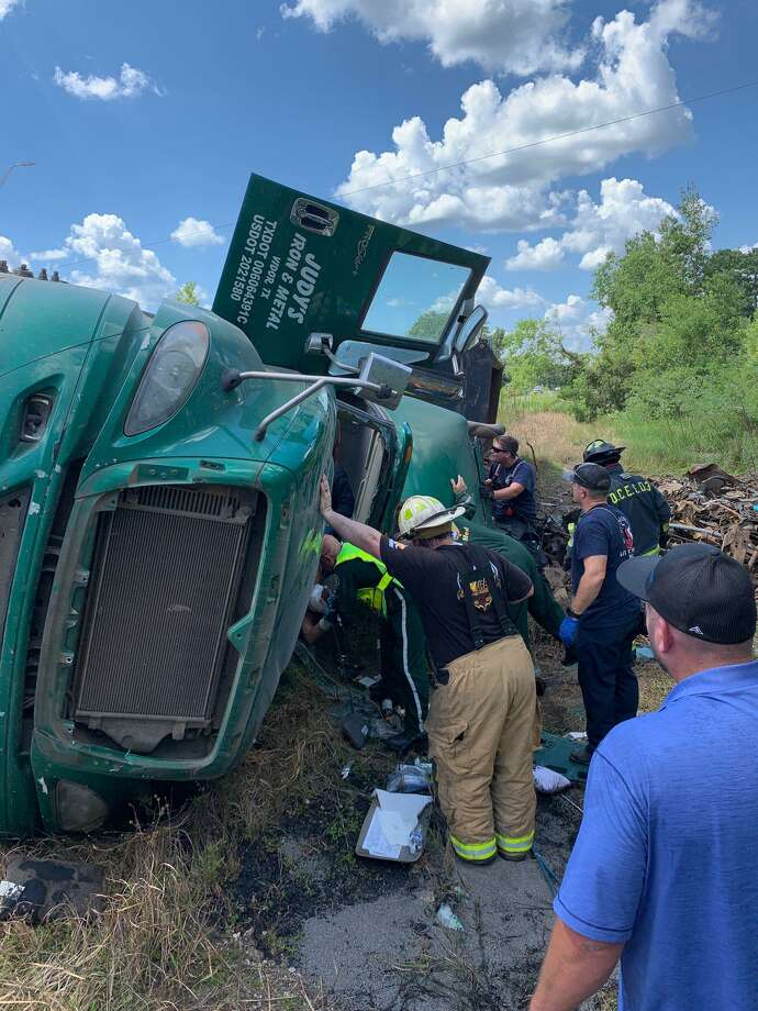 Emergency responders remove a man from an overturned tractor trailer on Highway 62 in Orange County on Tuesday. Photo: Photo Provided By Eric Williams