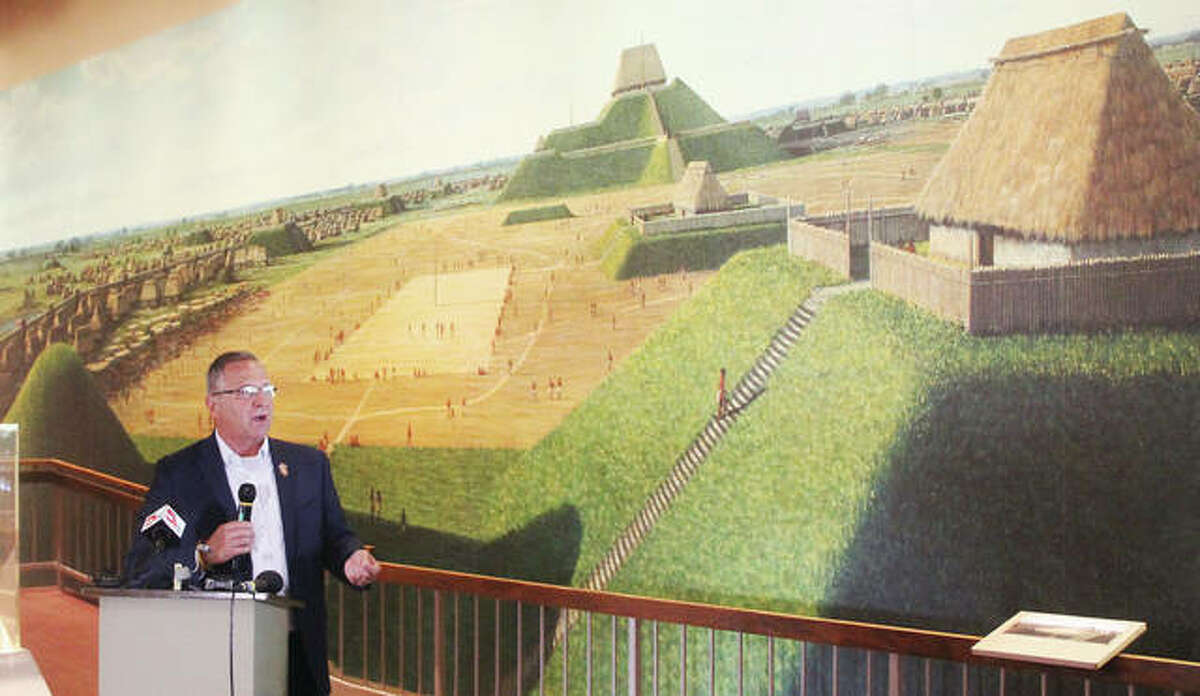 U.S. Rep. Mike Bost, R-Murphysboro, talks Tuesday morning in front of a mural depicting the ancient city of Cahokia at its height during a press conference at the Cahokia Mounds State Historic Site Interpretive Center. Bost has introduced legislation to elevate Cahokia Mounds and related local sites to national park status.