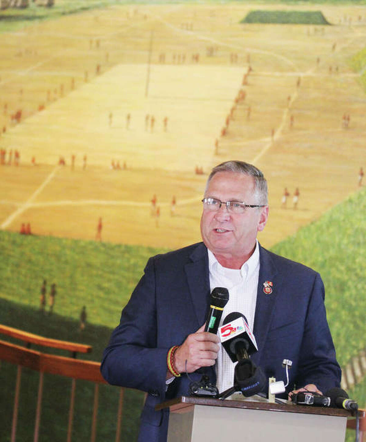 U.S. Rep. Mike Bost, R-Murphysboro, talks Tuesday in front of a mural depicting the ancient city of Cahokia at its height during a press conference at the Cahokia Mounds State Historic Site Interpretive Center. The mural depicts the city's residents playing a game called Chunkey. Bost has introduced legislation to elevate Cahokia Mounds and related local sites to national park status.