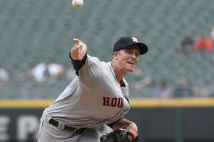 Houston Astros starting pitcher Zack Greinke (21) throws against the Chicago White Sox during the first inning of game one of a baseball doubleheader, Tuesday, Aug. 13, 2019, in Chicago. (AP Photo/David Banks)