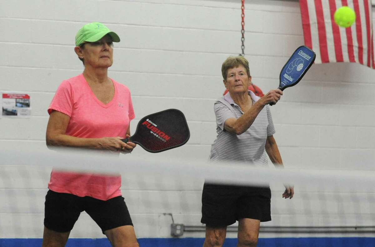 Nancy Crowley and Marge Connelly play Pickleball at the Norwalk Senior Center Wednesday, Sept. 12, 2018, in Norwalk, Conn. The center offers pickleball three times a week to allow seniors to get some exercise despite inclement weather.