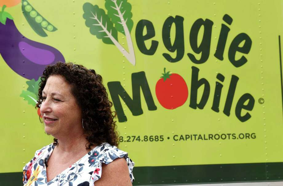 Capital Roots CEO Amy Klein speaks during the unveiling of the nonprofit's new Veggie Mobile on Tuesday, Aug. 13, 2019, in Troy, N.Y. The truck is used to provide fresh produce to inner-city neighborhoods throughout the Capital Region. (Will Waldron/Times Union) Photo: Will Waldron / 20047608A
