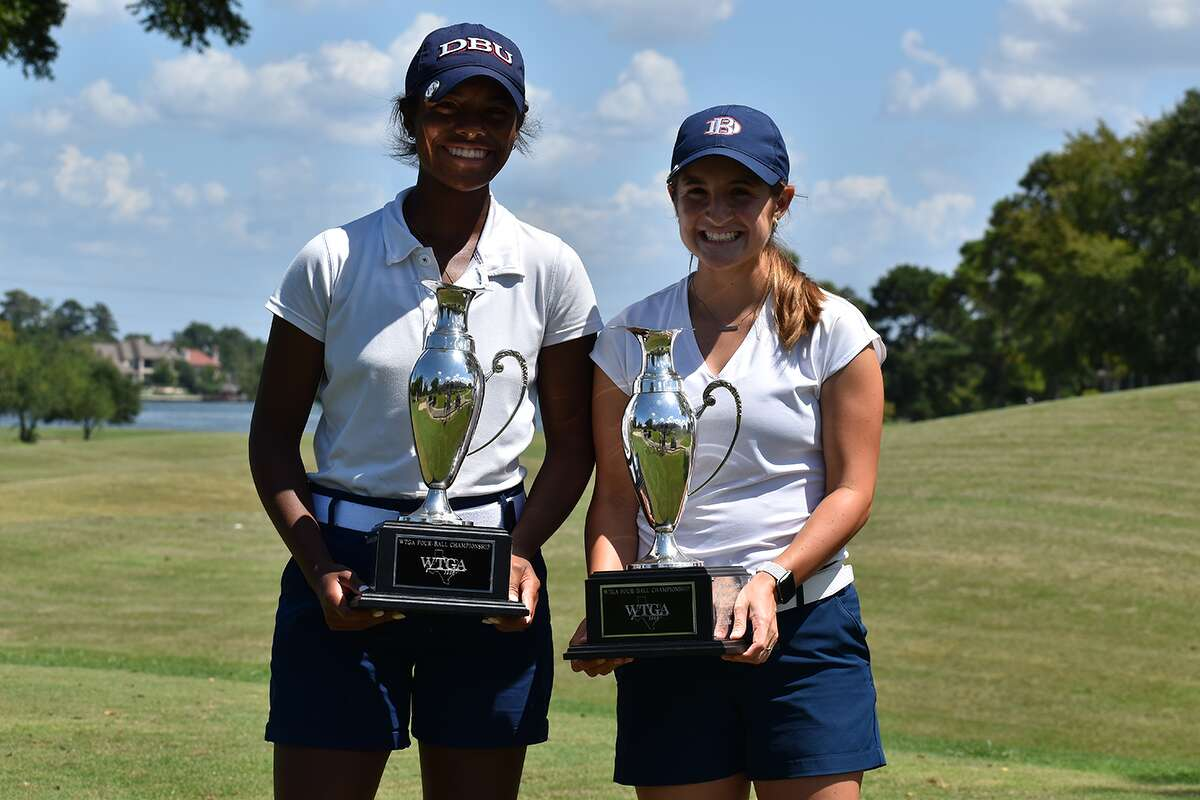 Midland High grad Faith DeLaGarza, right, and Amari Smith hold their trophies after they teamed to win the Women's Four-Ball Championship, Tuesday at Bentwater Country Club in Montgomery.